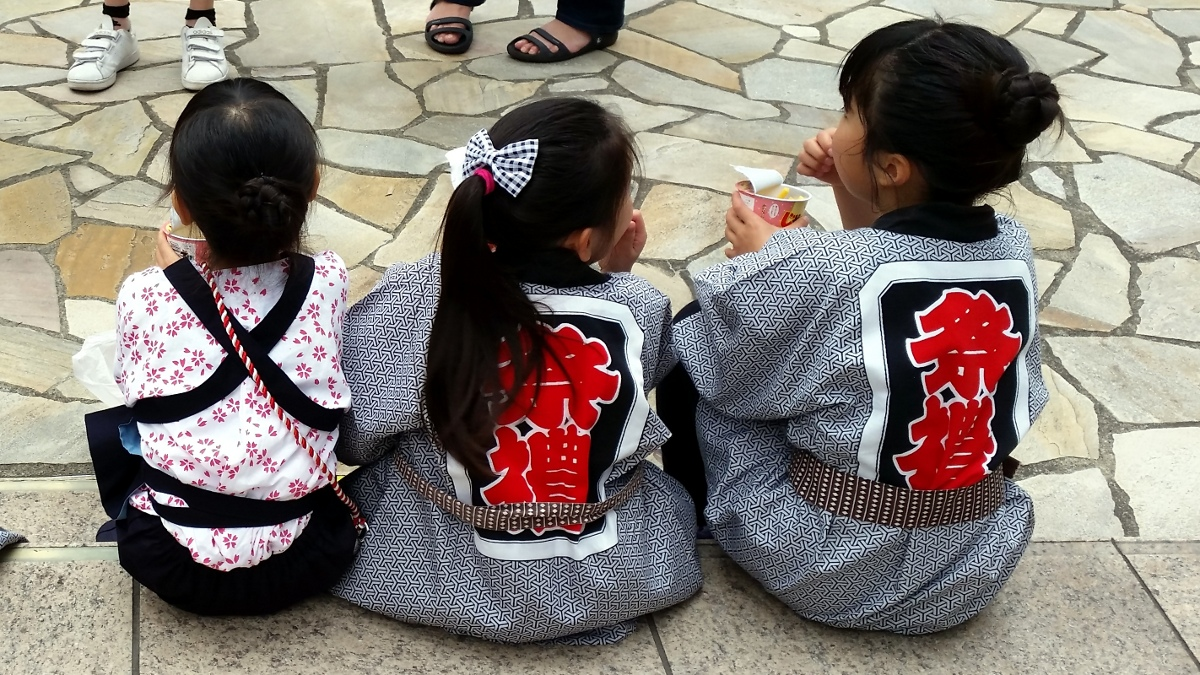 Japanese girls in happi during Kanda-matsuri in Jimbocho area (Chiyoda ward, Tokyo, Japan) on 09 May 2015.