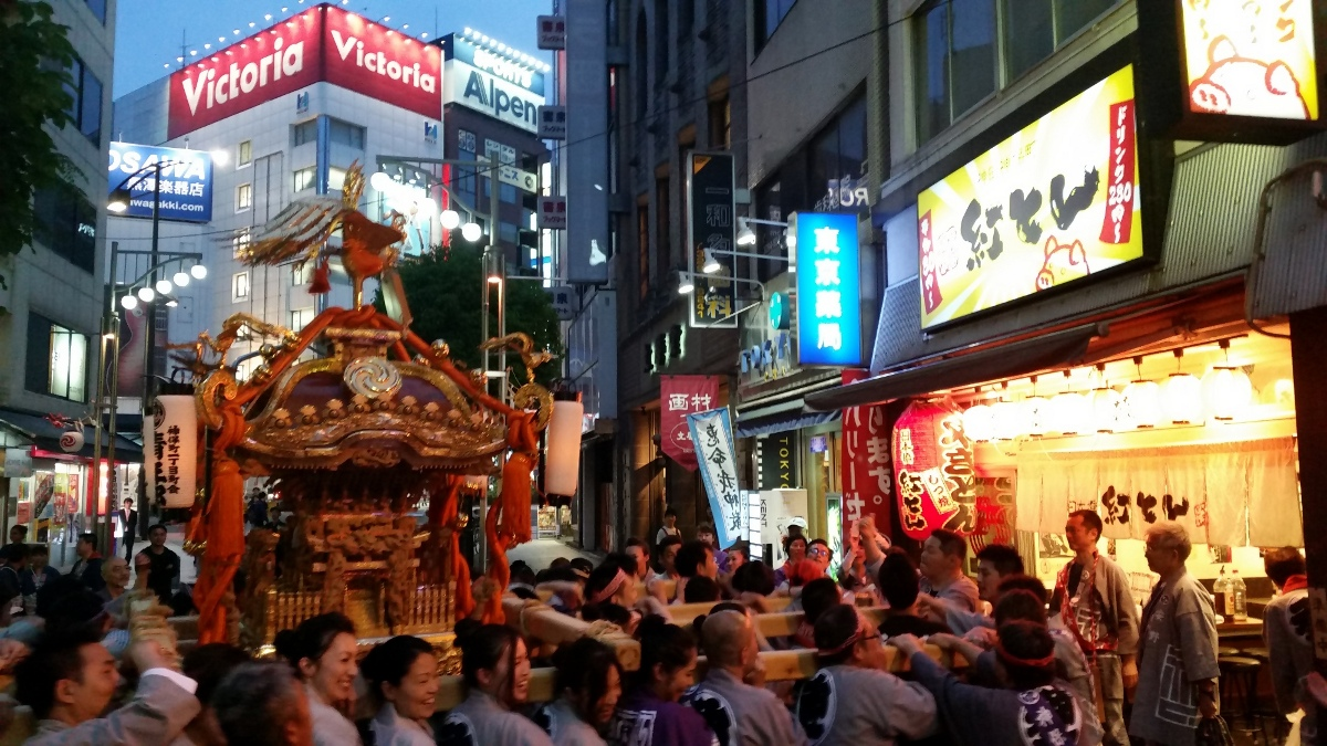 Japanese girls carrying the omikoshi of Jimbocho-itchome at night during Kanda-matsuri in Jimbocho area (Chiyoda ward, Tokyo, Japan) on 09 May 2015.